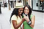 Two Women with Cell Phone Stock Photo - Premium Rights-Managed, Artist: Peter Griffith, Code: 700-05451003