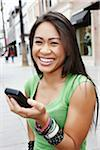Smiling Woman with Cell Phone Stock Photo - Premium Rights-Managed, Artist: Peter Griffith, Code: 700-05451005