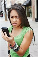 Angry Woman with Cell Phone Stock Photo - Premium Rights-Managednull, Code: 700-05451007