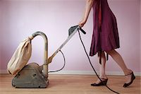 Woman Wearing Dress Using Electric Sander on Hardwood Floor Stock Photo - Premium Rights-Managednull, Code: 700-05451142