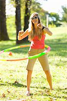 Woman Playing with Hula-Hoop in Park Stock Photo - Premium Rights-Managednull, Code: 700-05452078