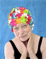 seniors and swim cap - Senior woman in swimming cap and costume, hands on neck, portrait Stock Photo - Premium Royalty-Freenull, Code: 6106-05453170