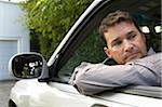 Man looking over shoulder out of window of car on driveway, close-up Stock Photo - Premium Royalty-Free, Artist: Multi-bits, Code: 6106-05453323