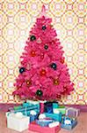 Fake pink Christmas tree surrounded by gifts Stock Photo - Premium Royalty-Free, Artist: Marie Blum, Code: 6106-05454253