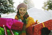 Mature woman holding presents in snow, smiling, portrait, close-up Stock Photo - Premium Royalty-Freenull, Code: 6106-05454667