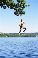 England, Cumbria, Windermere, boy (11-13) jumping into lake Stock Photo - Premium Royalty-Freenull, Code: 6106-05455008