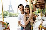 France, Paris, couple riding carousel, man behind woman, portrait Stock Photo - Premium Royalty-Freenull, Code: 6106-05455032