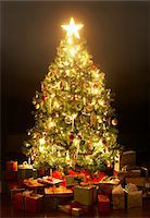 present wrapped close up - Presents around lit Christmas tree with star Stock Photo - Premium Royalty-Freenull, Code: 6106-05456277