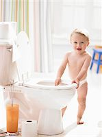 Male toddler (18-21 months) standing by toilet Stock Photo - Premium Royalty-Freenull, Code: 6106-05456292