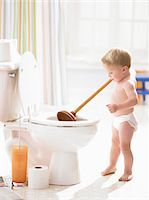 Male toddler (18-21 months) using bathroom plunger on toilet Stock Photo - Premium Royalty-Freenull, Code: 6106-05456297