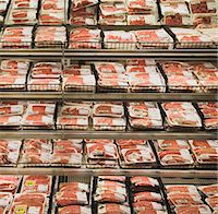 Shelves of packaged meat in grocery store Stock Photo - Premium Royalty-Freenull, Code: 6106-05456536