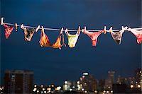 Women's underwear hanging on line, night Stock Photo - Premium Royalty-Freenull, Code: 6106-05457070