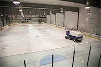 Man resurfacing ice at indoor hockey arena Stock Photo - Premium Royalty-Freenull, Code: 6106-05458778