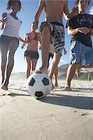 Group of teenagers (16-18) and young men and women playing football Stock Photo - Premium Royalty-Freenull, Code: 6106-05462055