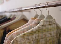 Plaid Shirts on Hangers Stock Photo - Premium Royalty-Freenull, Code: 6106-05468046
