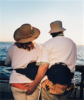 Tourists Looking at Sea Stock Photo - Premium Royalty-Freenull, Code: 6106-05469312