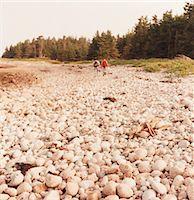 Men Walking on Rocky Beach Stock Photo - Premium Royalty-Freenull, Code: 6106-05469529