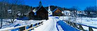 panoramic winter scene - This is a small town in New England showing a white Methodist Church with steeple. There is a snow covered bridge in the foreground with older looking brown wood buildings behind it. The bare trees of winter surround the buildings. Stock Photo - Premium Royalty-Freenull, Code: 6106-05472447