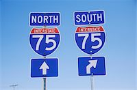 Interstate Highway 75 North and South Freeway signs Stock Photo - Premium Royalty-Freenull, Code: 6106-05472775