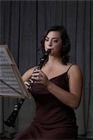 Woman playing clarinet Stock Photo - Premium Royalty-Freenull, Code: 6106-05474498