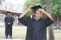 Young graduate student holding mortar board, portrait Stock Photo - Premium Royalty-Freenull, Code: 6106-05476039