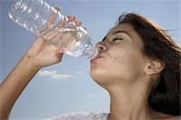 Girl (10-12) drinking from water bottle outdoors, close-up Stock Photo - Premium Royalty-Freenull, Code: 6106-05476147