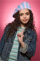 preteens fingering - Portrait of girl (10-11) wagging finger, wearing hat Stock Photo - Premium Royalty-Freenull, Code: 6106-05480246