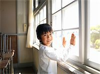 Boy (5-7) cleaning classroom window, portrait Stock Photo - Premium Royalty-Freenull, Code: 6106-05480779