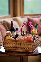 Wine bottles in basket at home Stock Photo - Premium Royalty-Freenull, Code: 6106-05483897
