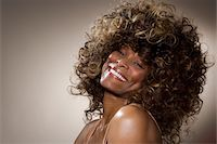 Mature woman smiling, portrait, close-up Stock Photo - Premium Royalty-Freenull, Code: 6106-05485659