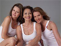 Three mature women, smiling, portrait Stock Photo - Premium Royalty-Freenull, Code: 6106-05486029