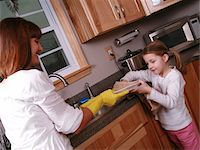 A daughter helping her mother with household chores. Stock Photo - Premium Royalty-Freenull, Code: 6106-05488099