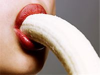 sucking - close up of woman eating banana Stock Photo - Premium Royalty-Freenull, Code: 6106-05491720
