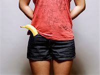 young asian woman with banana in her pocket Stock Photo - Premium Royalty-Freenull, Code: 6106-05491723