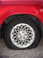 Automobile with flat tire Stock Photo - Premium Royalty-Freenull, Code: 6106-05492362