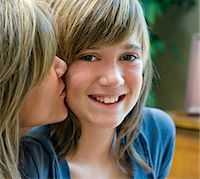 preteen kissing - Mom Kissing Smiling Daughter on Cheek Stock Photo - Premium Royalty-Freenull, Code: 6106-05496306