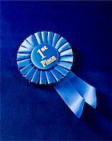 1st place ribbon on blue velvet Stock Photo - Premium Royalty-Freenull, Code: 6106-05497166