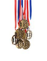 Bunch of 1st place medals Stock Photo - Premium Royalty-Freenull, Code: 6106-05497167