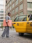 Business woman getting into taxi Stock Photo - Premium Royalty-Free, Artist: ableimages, Code: 6106-05497785