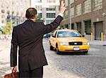 Business man hailing taxi Stock Photo - Premium Royalty-Free, Artist: ableimages, Code: 6106-05497796