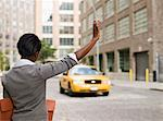 Business woman hailing taxi Stock Photo - Premium Royalty-Free, Artist: ableimages, Code: 6106-05497805