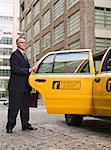 Business man getting into Taxi Stock Photo - Premium Royalty-Free, Artist: ableimages, Code: 6106-05497814