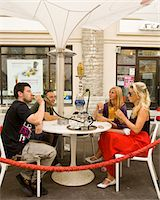 Enjoying shisha (water pipe) at an outdoor cafe Stock Photo - Premium Royalty-Freenull, Code: 6106-05500652