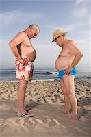 fat man full body - Two senior men on beach, comparing abdomens, side view Stock Photo - Premium Royalty-Freenull, Code: 6106-05502970