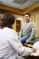 Doctor and patient in consultation Stock Photo - Premium Royalty-Freenull, Code: 6106-05504514
