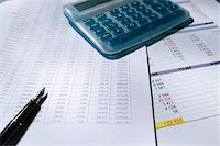 Calculator and fountain pen on spreadsheet, elevated view Stock Photo - Premium Royalty-Freenull, Code: 6106-05506458