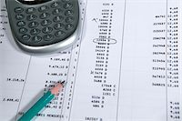 Calculator and pencil on spreadsheet, close up Stock Photo - Premium Royalty-Freenull, Code: 6106-05506462