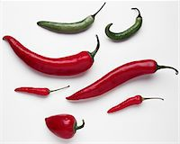 spicy - Assorted red and green hot peppers on white background Stock Photo - Premium Royalty-Freenull, Code: 6106-05506632