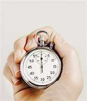 stop watch - Man holding stopwatch, close-up Stock Photo - Premium Royalty-Freenull, Code: 6106-05507634