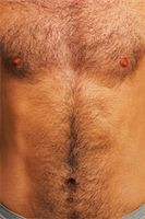 Close-up of young man's chest Stock Photo - Premium Royalty-Freenull, Code: 6106-05507766